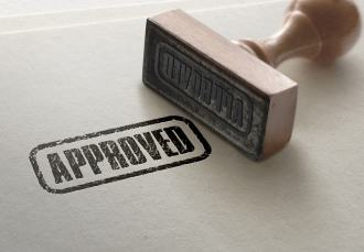 Access Peer Review Ink Stamp on piece of paper saying APPROVED
