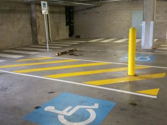 Accessible Car Parking in a basement car park, with two spaces and a central shared area between each space