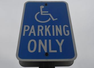 Accessible Car Parking Street Sign, on a pole, saying PARLING ONLY