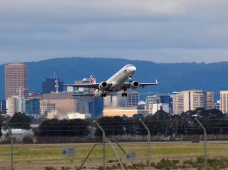 Adelaide airport with a plane taking off
