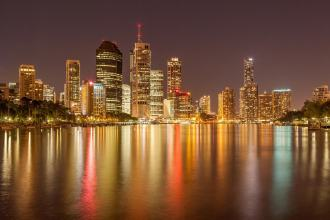 Brisbane CBD at night with lights reflecting on water