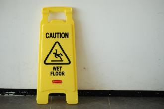 Caution wet Floor Sign leaning against a wall