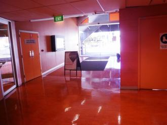 Entrance to a university, inside the entry doors, with a high gloss red shining floor