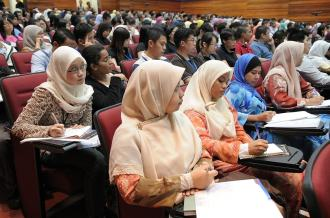 Lecture hall with students all seated looking towards the front
