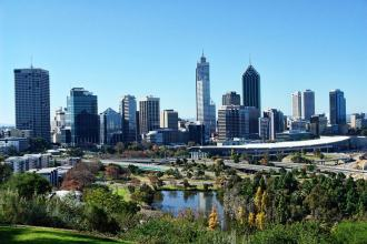 Perth skyline on a beautiful summers day with view over a park and lake