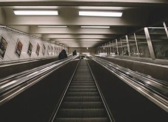 Subway station and escalator moving upwards