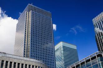 Tall office buildings against a blue skyline