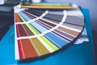 Paint fan deck with a range of different coloured paints