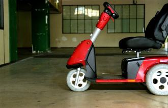 Electric scooter outer old building