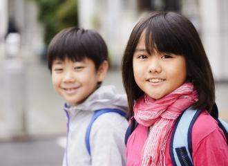 Boy and girl smiling at camera