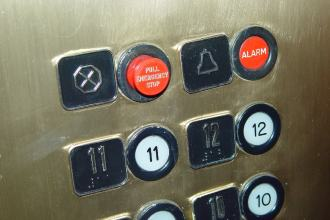 Close up of older non-compliant lift buttons