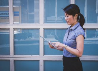 Female access consultant using a tablet PC doing a building inspection