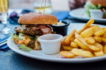 Burger and chips on a plate