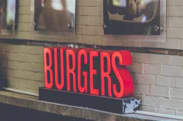 Burgers sign over a doorway