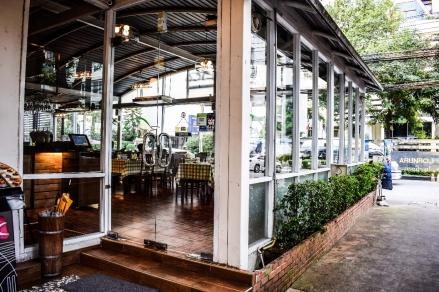 Garden cafe building with extensive glass windows.jpeg
