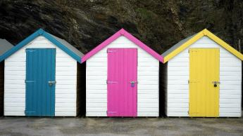 Beach huts with colourful doors